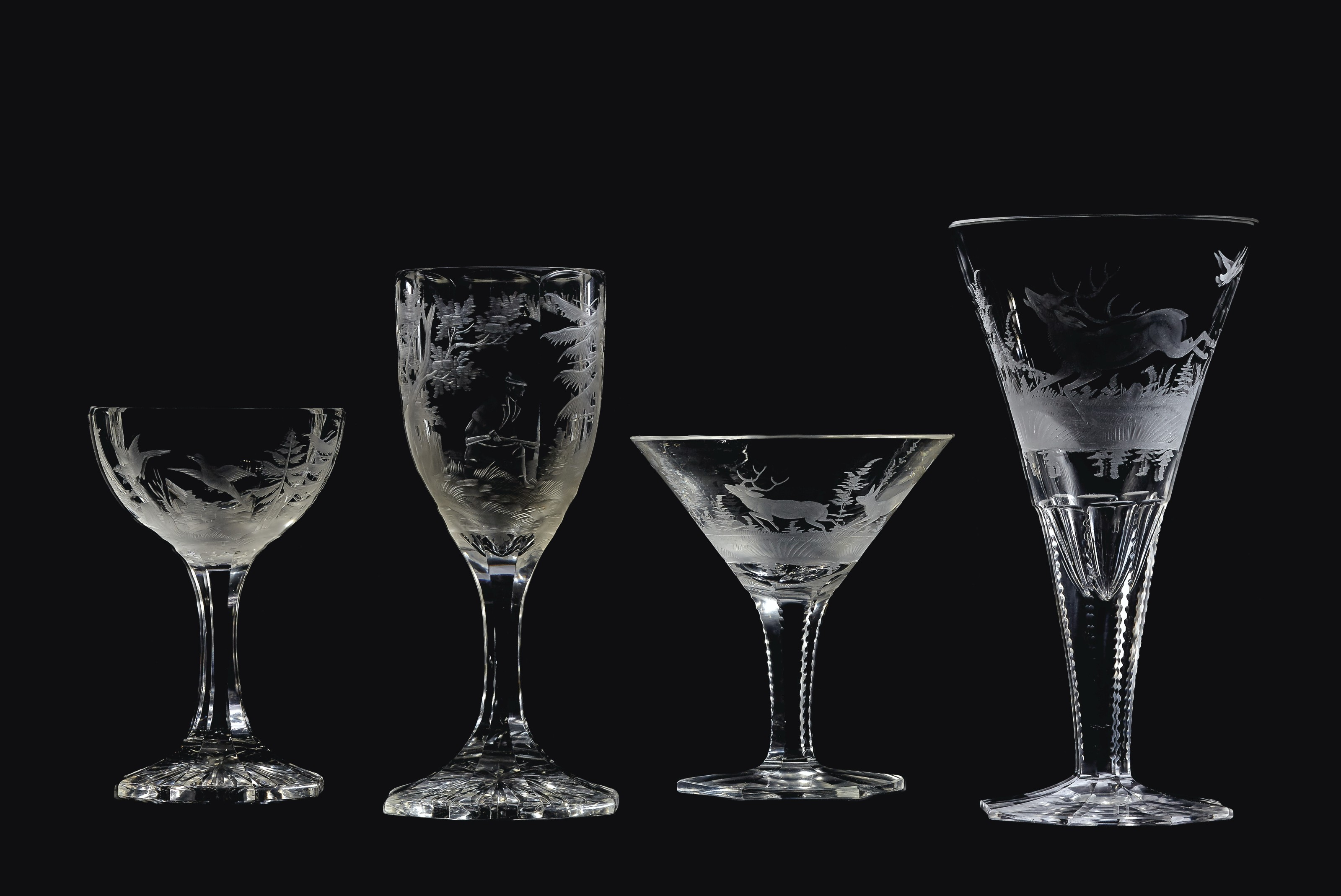 AN ASSEMBLED BOHEMIAN ENGRAVED AND CUT-GLASS PART STEMWARE SERVICE