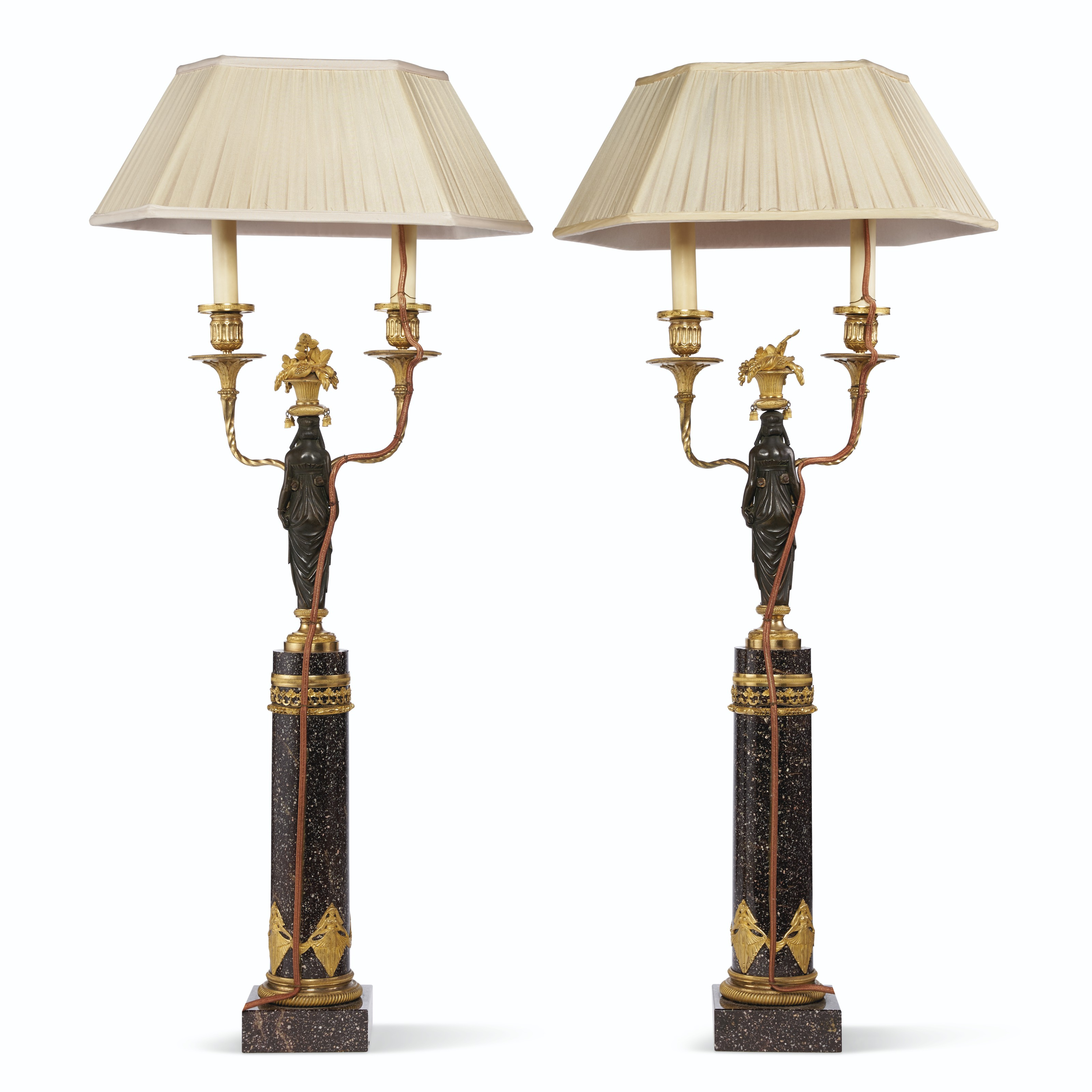 A PAIR OF SWEDISH PATINATED BRONZE, ORMOLU AND SVART BLYBERG PORPHYRY TWO-LIGHT CANDELABRA