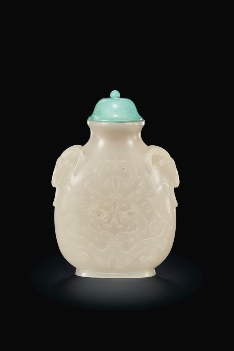 A well-carved white jade snuff bottle. Probably Imperial, attributed to the Palace Workshops, Beijing, 1736-1800. 2 58 in. (6.7 cm.) high. Estimate $15,000-25,000. Offered inImportant Chinese Art from the Junkunc Collectionon 18 March at Christies New York