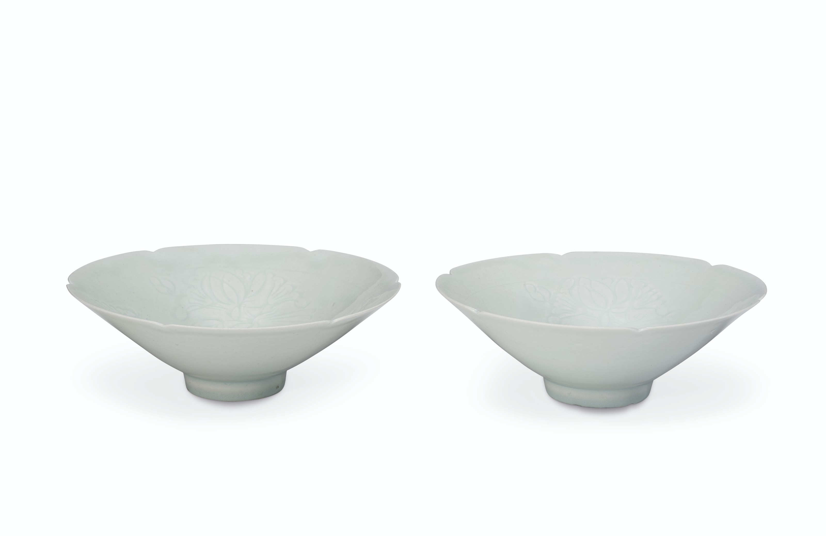 A PAIR OF CARVED QINGBAI BOWLS