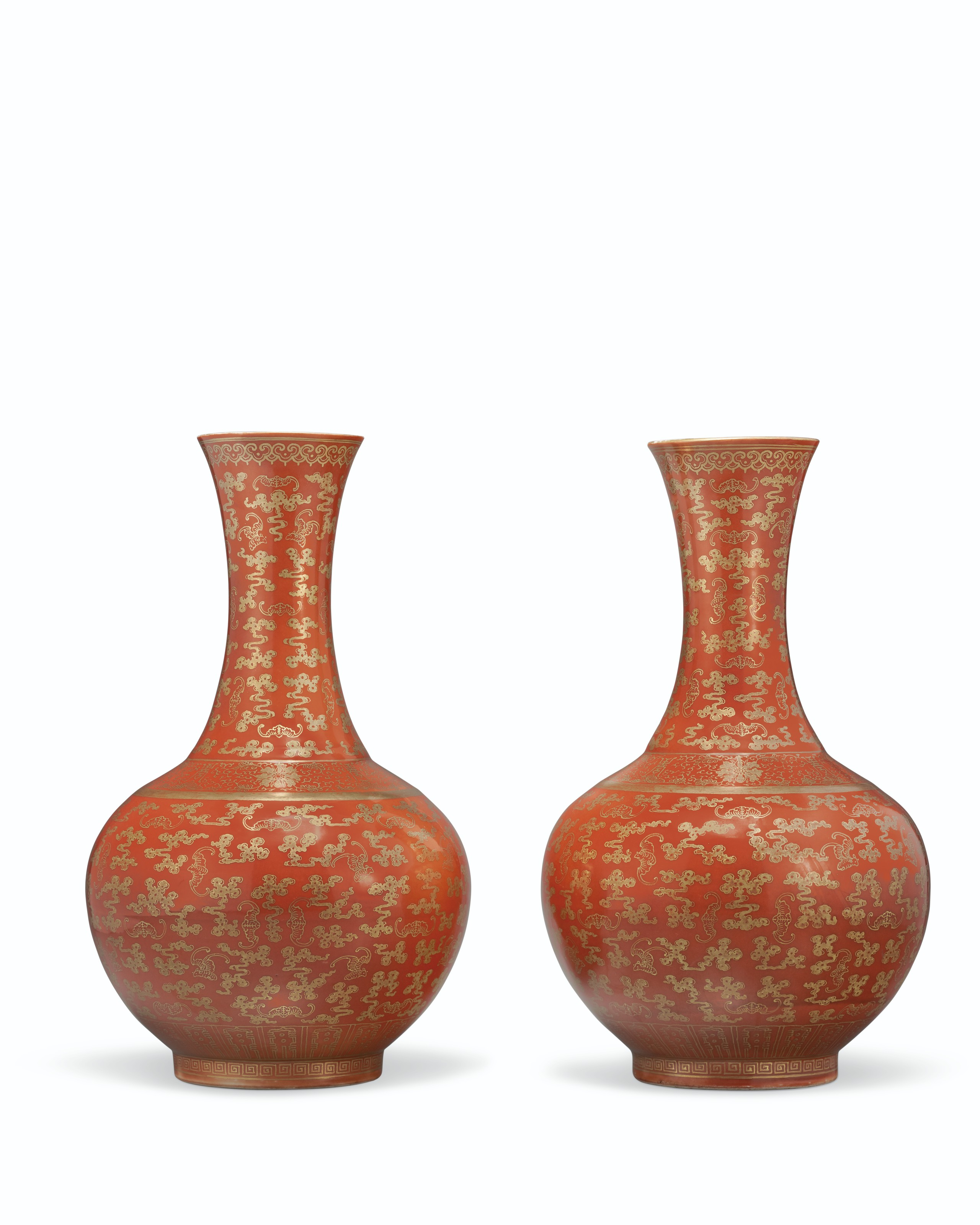A RARE PAIR OF GILT-DECORATED CORAL-GROUND BOTTLE VASES