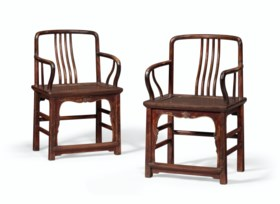 A PAIR OF LOW-BACK WALNUT AMRCHAIRS