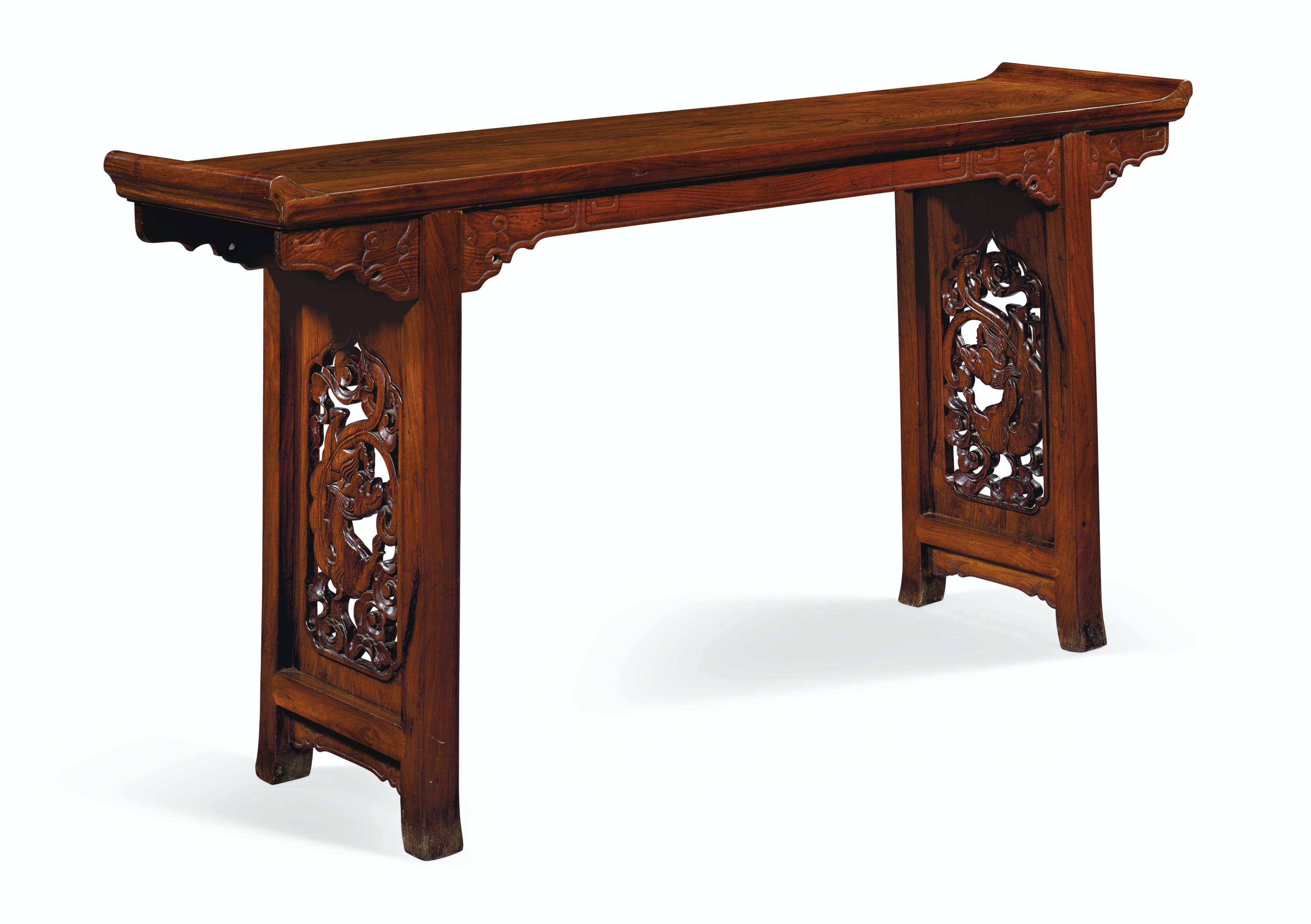 A RARE HUANGHUALI TRESTLE-LEG TABLE