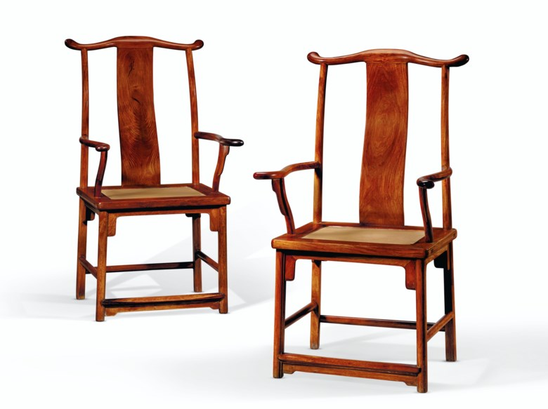 A rare pair of huanghuali officials hat armchairs. 19th-early 20th century. 44 12 in. (113 cm.) high, 23 34 in. (60.3 cm.) wide, 19 in. (48.3 cm.) deep. Estimate $40,000-60,000. Offered in Important Chinese Ceramics and Works of Art on 18-19 March 2021 at Christies New York