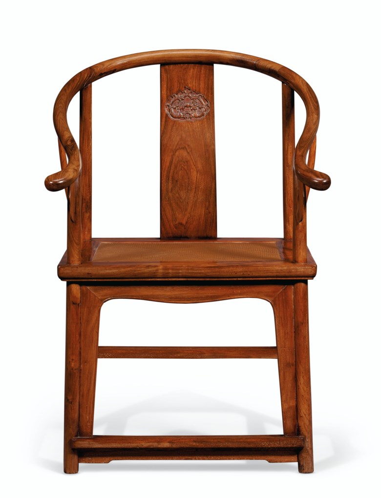 A rare huanghuali horseshoe-back armchair. 17th-18th century. 38 14 in. (97.2 cm.) high, 25 14 in. (64.2 cm.) wide, 21 in. (53.4 cm.) deep. Estimate $60,000-80,000. Offered in Important Chinese Ceramics and Works of Art on 18-19 March 2021 at Christies New York