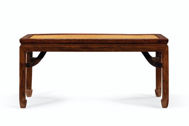 A huanghuali bench. 18th-19th century. 20 14 in. (51.5 cm.) high, 43 in. (109.2 cm.) wide, 16 18 in. (41 cm.) deep. Estimate $25,000-35,000. Offered in Important Chinese Ceramics and Works of Art on 18-19 March 2021 at Christie's New York
