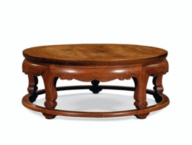 AN UNUSUAL HUANGHUALI ROUND LOW TABLE