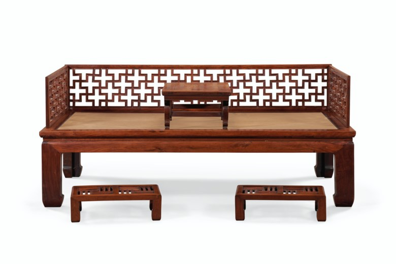 A huanghuali luohan bed, kang table and a pair of hongmu foot stools. 18th-19th century with alterations. Estimate $50,000-70,000. Offered in Important Chinese Ceramics and Works of Art on 18-19 March 2021 at Christies New York