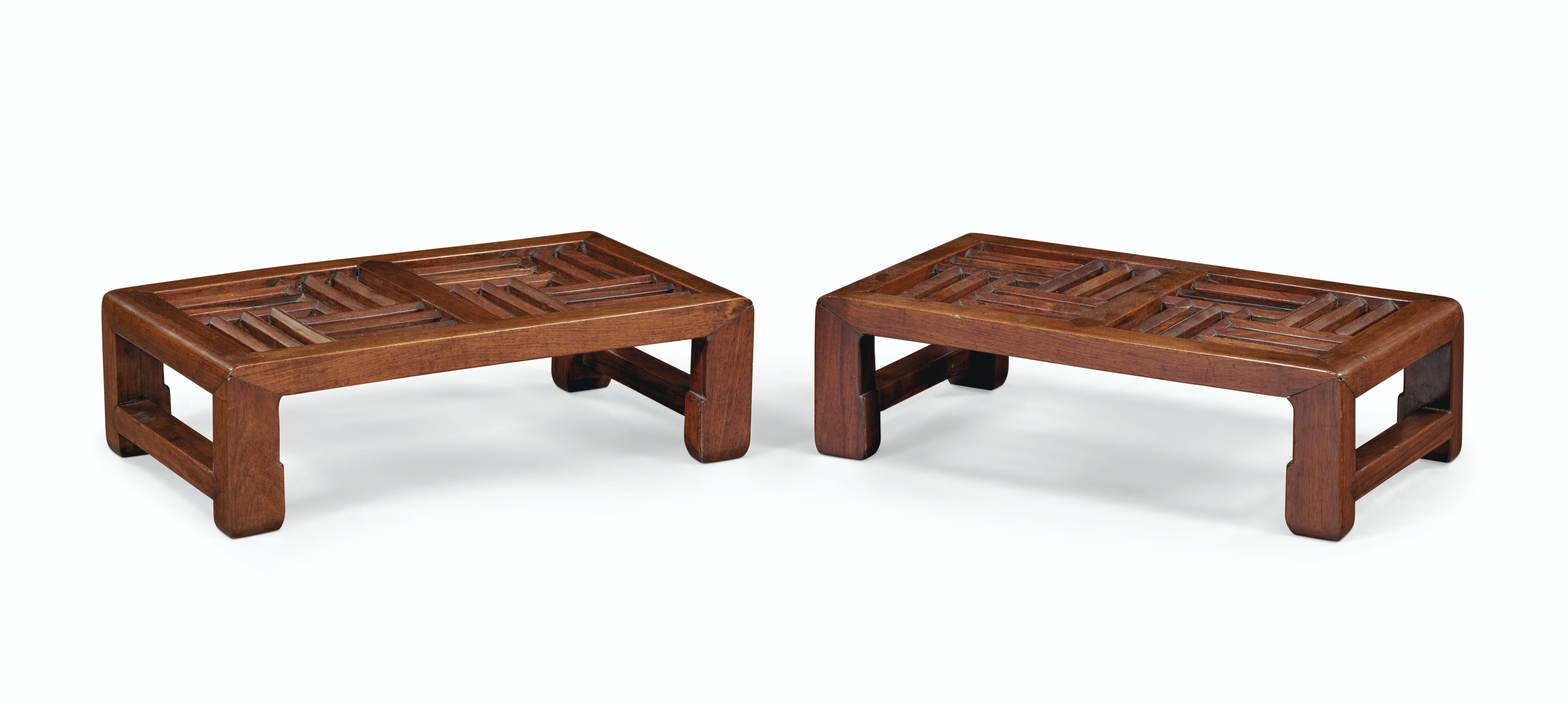 A HUANGHUALI LUOHAN BED, KANG TABLE, AND A PAIR OF HONGMU FOOT STOOLS