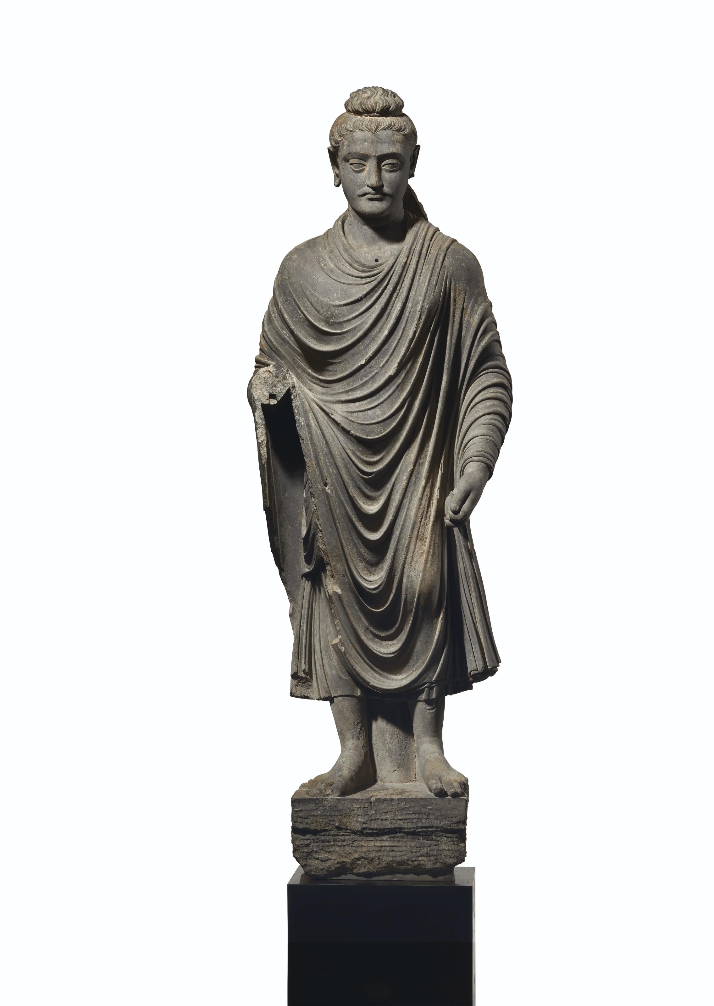 A MAGNIFICENT AND MONUMENTAL GRAY SCHIST FIGURE OF BUDDHA SHAKYAMUNI