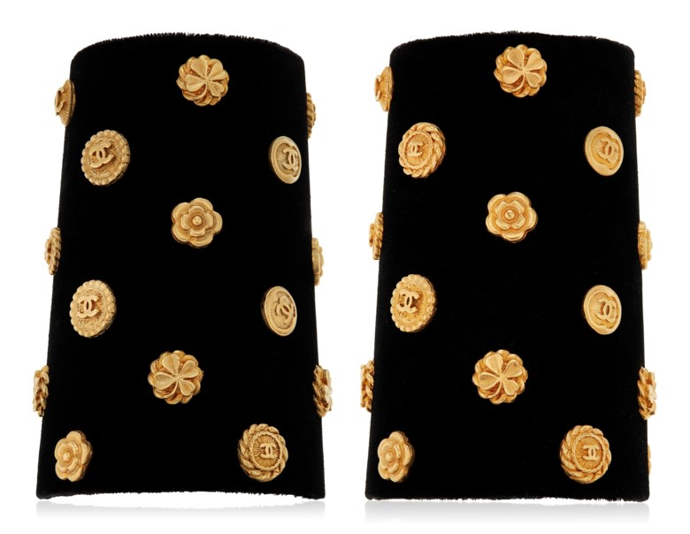 Unsigned Chanel pair of fabric and leather cuffs, late 20th century. Accompanied by a Chanel dust bag. Sold for $3,000 in Susan and Karl Important Chanel Fashion Jewelry from the Collection of Mrs. John H. Gutfreund, 14-29 January 2021, Online