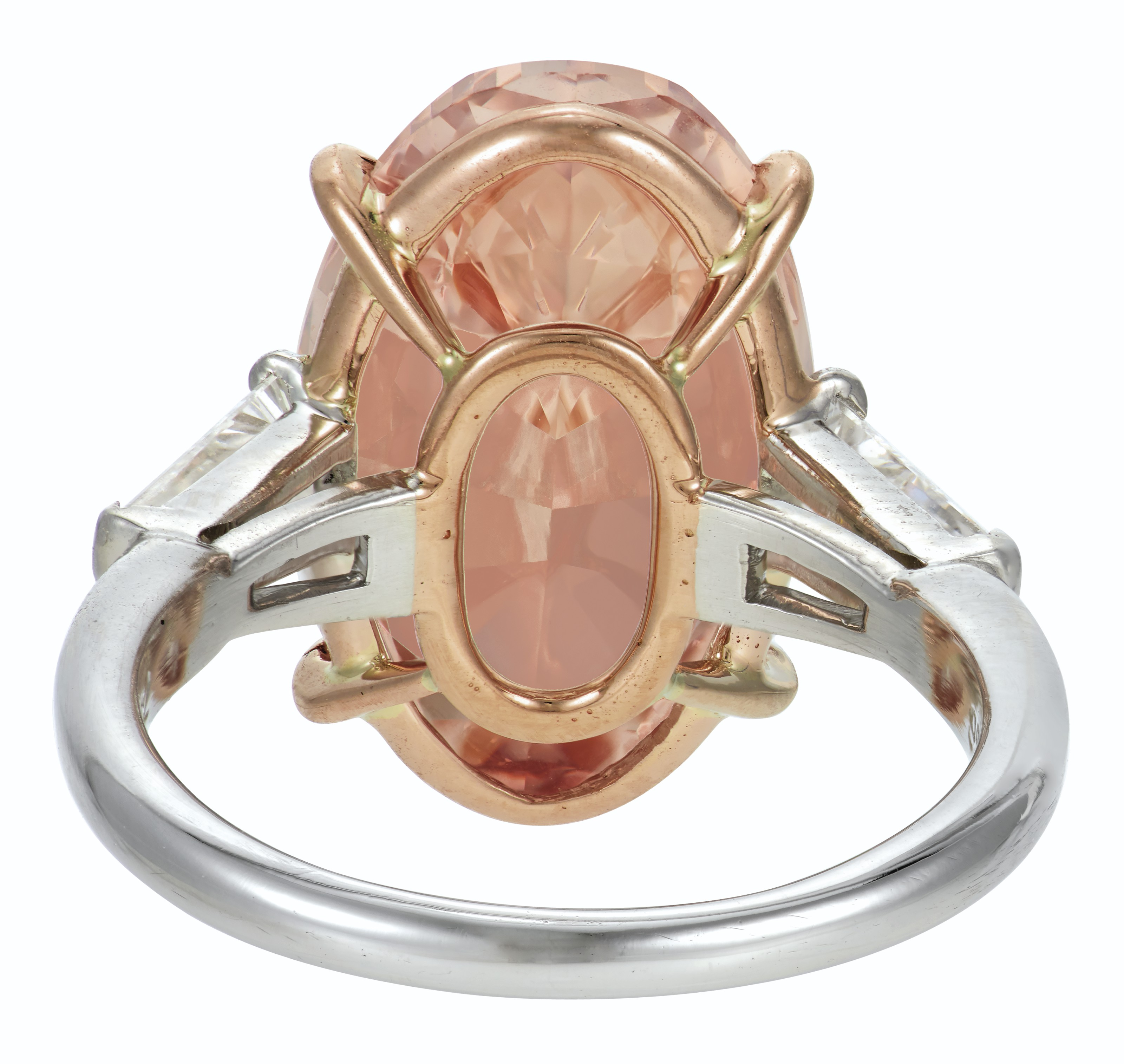 A RARE COLORED DIAMOND AND DIAMOND RING