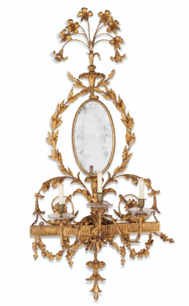 A pair of George III giltwood girandoles, circa 1775. 55½ (141 cm) high; 26¼ (67 cm) wide. Estimate $30,000-50,000. Offered in The Collection of Mrs. Henry Ford II Palm Beachon 30 March 2021 at Christie's in New York