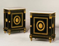 A PAIR OF CONSULAT ORMOLU-MOUNTED AND BRASS-INLAID EBONY MEUBLES D'APPUI