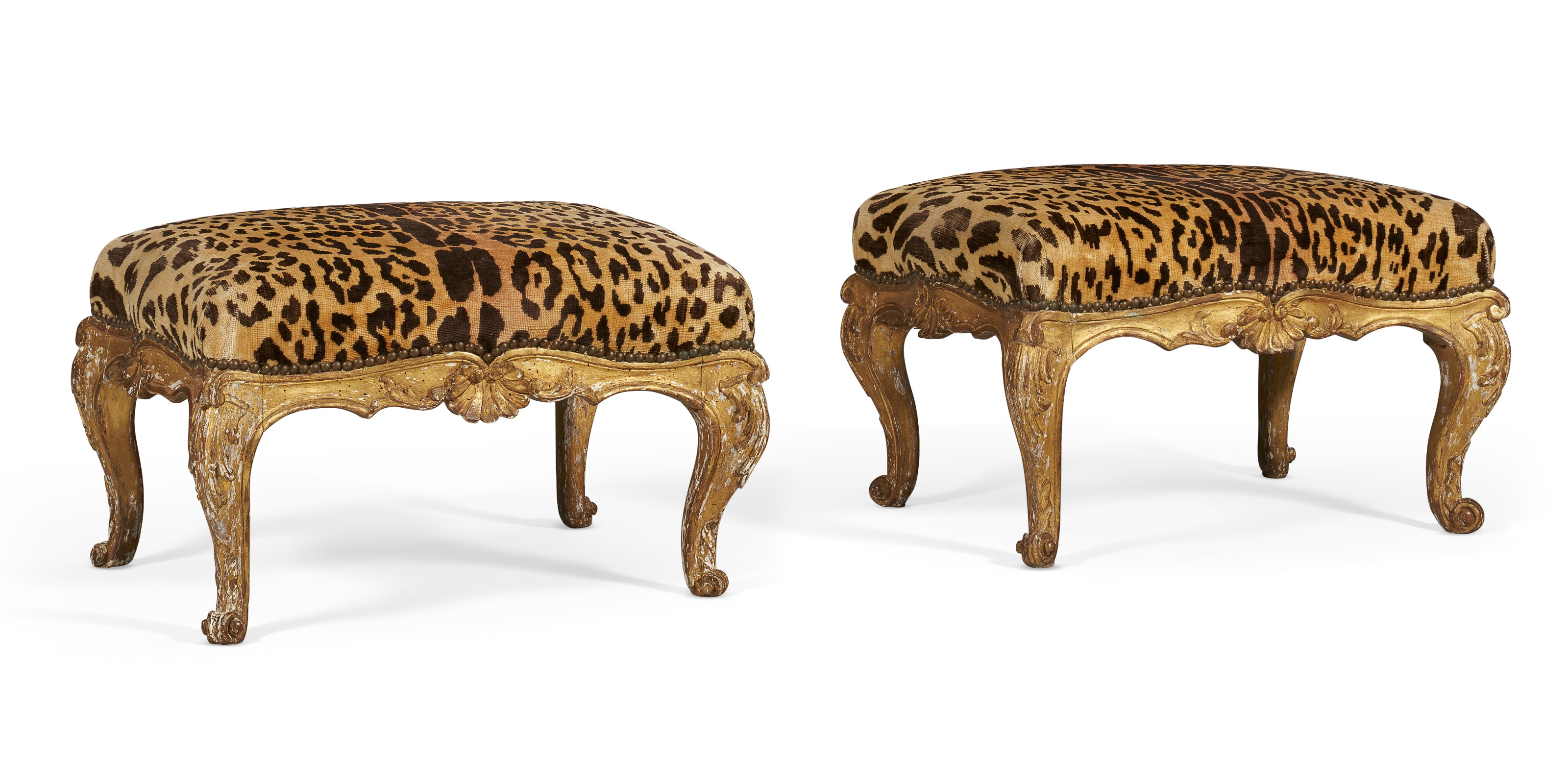 A pair of north Italian giltwood tabourets, c. 1750-55. Each of rectangular form and covered in leopard print upholstery, with scalloped foliate rail centered with shells, on cabriole legs terminating in scrolled feet. 12  in (30.5  cm) high, 21  in (53.5  cm) wide, 16¼  in (41.5  cm) deep. Estimate $3,000-5,000. Offered in The Collector English & European Furniture, Ceramics, Silver