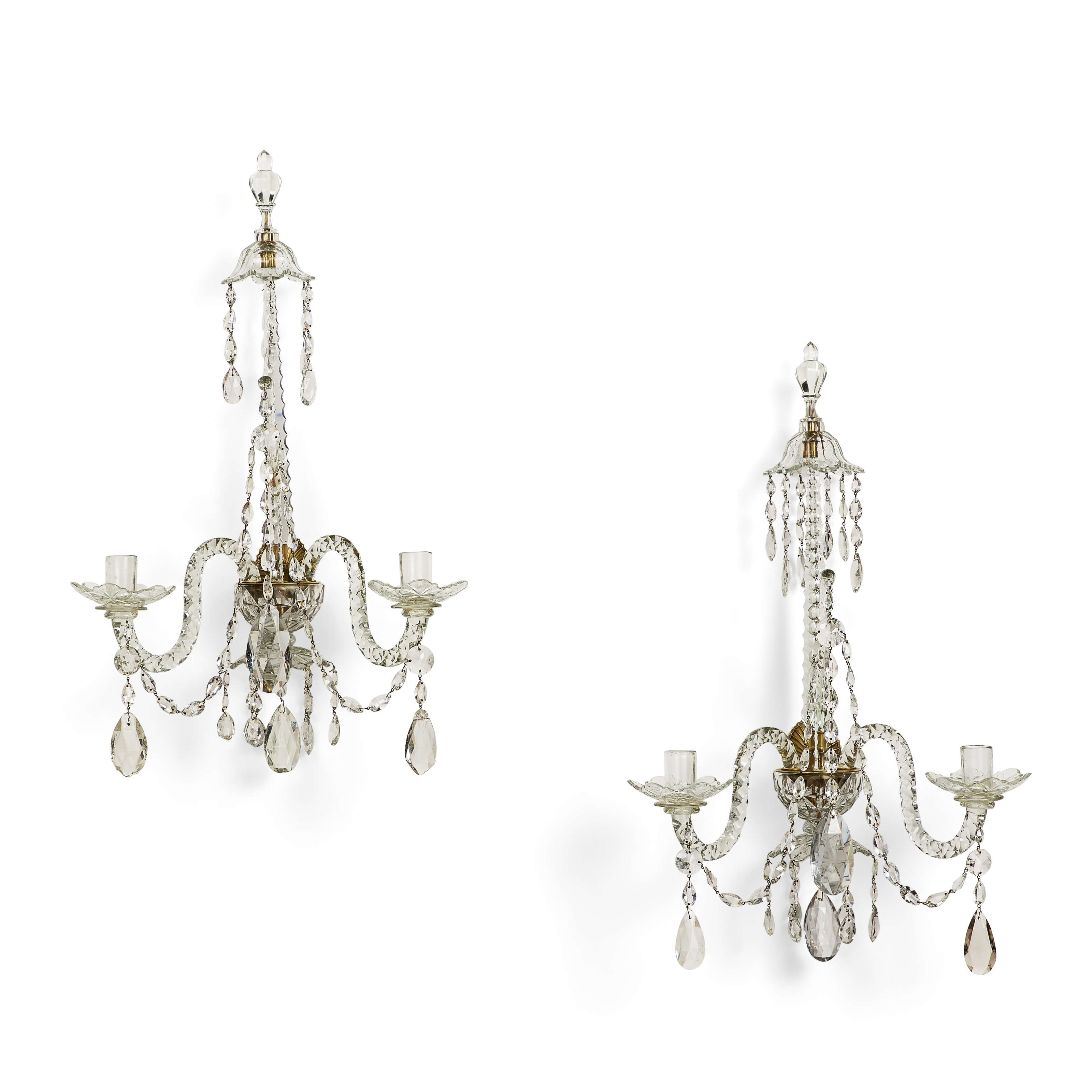A pair of late George III cut-class two-branch wall lights, c. 1790. 28½  in (72.5  cm) high, 18  in (46  cm) wide, 12  in (30.5  cm) deep. Estimate $8,000-12,000. Offered in The Collector English & European Furniture, Ceramics, Silver & Works of Art on 5-19 October 2021 at Christies Online