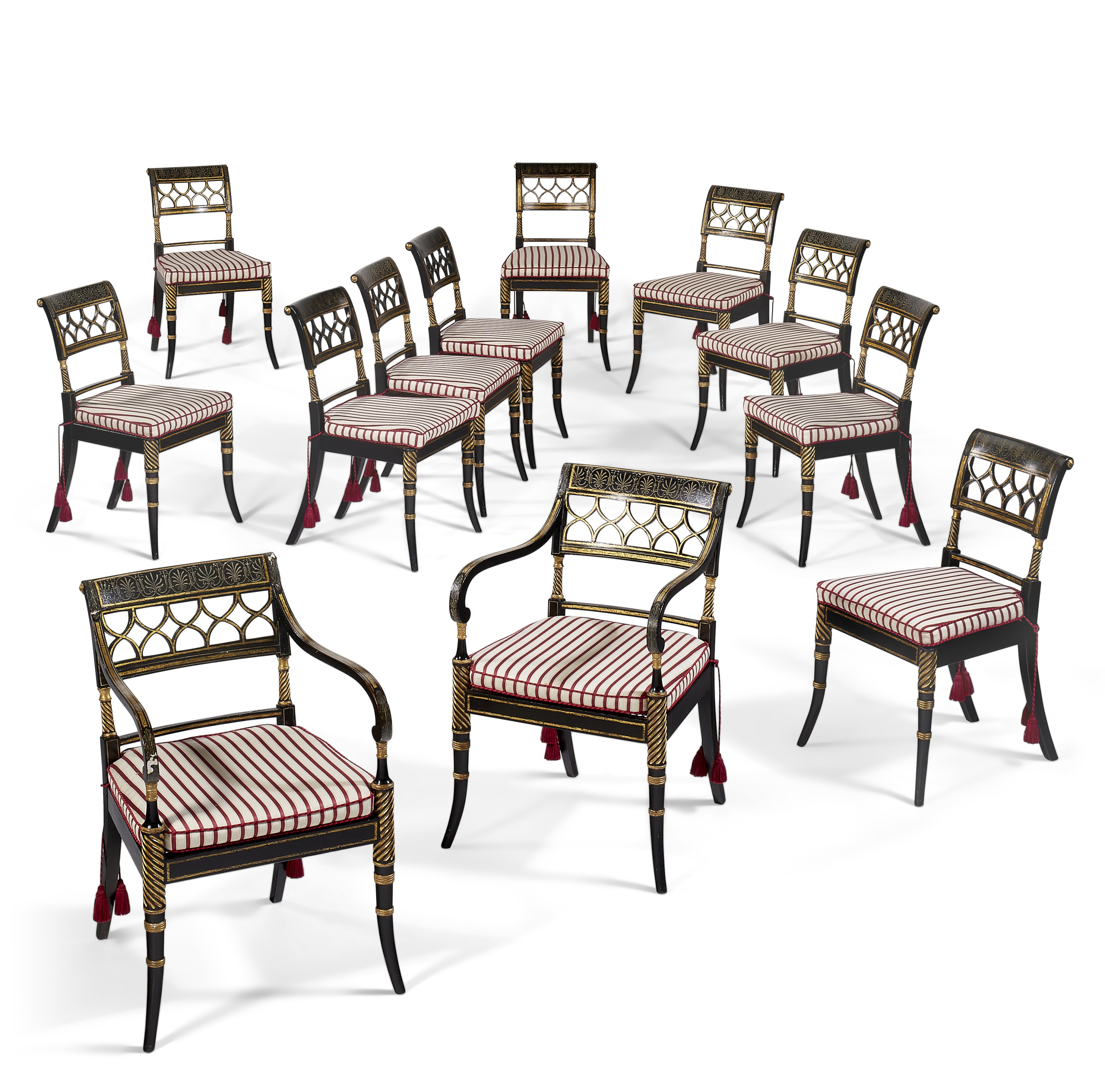 A set of twelve Regency ebonized and parcel-gilt dining chairs, eight c. 1815, four side chairs of a later date. The armchairs 33  in (84  cm) high. The side chairs 32¾  in (83  cm) high. Estimate $6,000-10,000. Offered in The Collector English & European Furniture, Ceramics, Silver & Works of Art on 5-19 October 2021 at Christie's Online