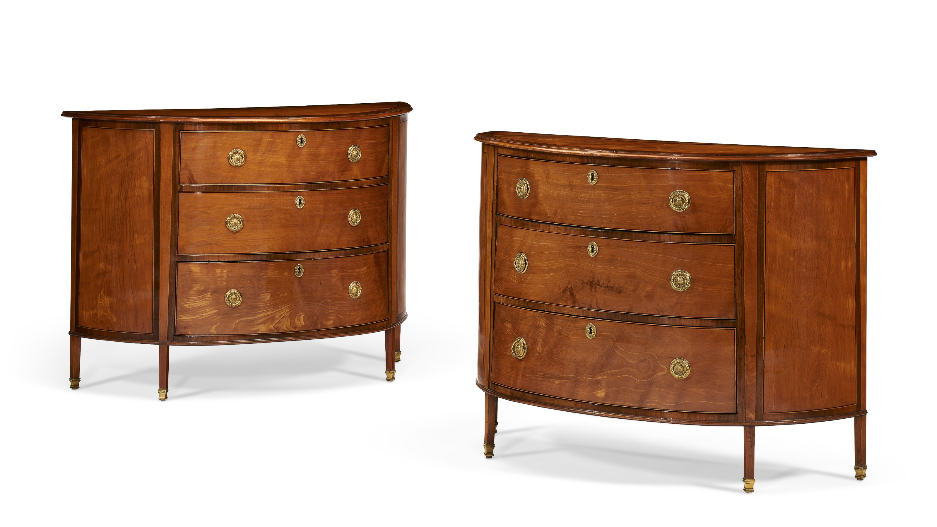A near pair of George III inlaid satinwood commodes, c. 1780, attributed to Ince and Mayhew. 34¾  in (88  cm) high, 48  in (122  cm) wide, 19½  in (49.5  cm) deep. Estimate $10,000-15,000. Offered in The Collector English & European Furniture, Ceramics, Silver & Works of Art on 5-19 October 2021 at Christie's Online