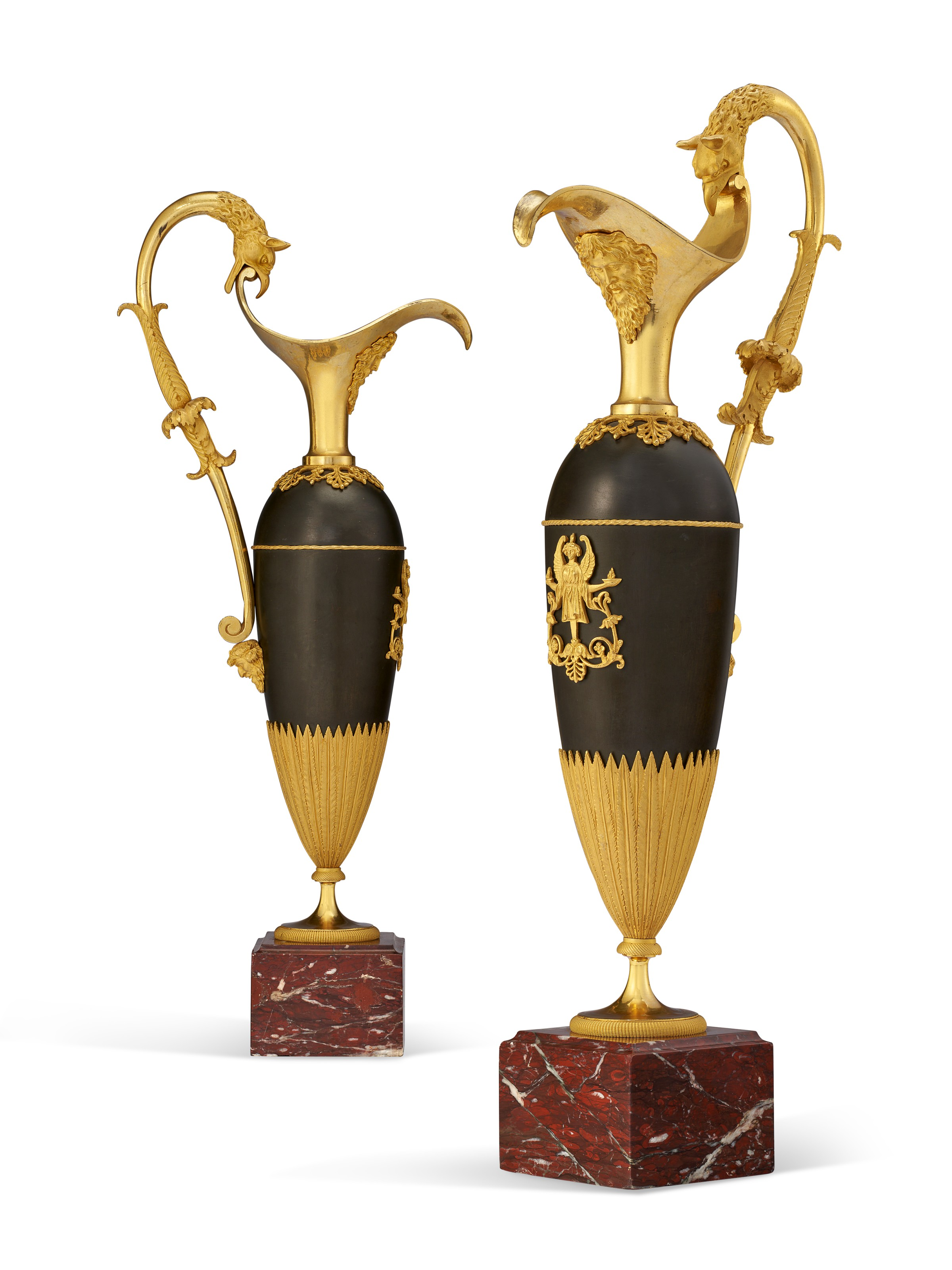 A pair of empire ormolu and patinated bronze ewers, attributed to Claude Galle, c. 1805. 21½  in (55  cm) high. Estimate $10,000-15,000. Offered in The Collector English & European Furniture, Ceramics, Silver & Works of Art on 5-19 October 2021 at Christie's Online