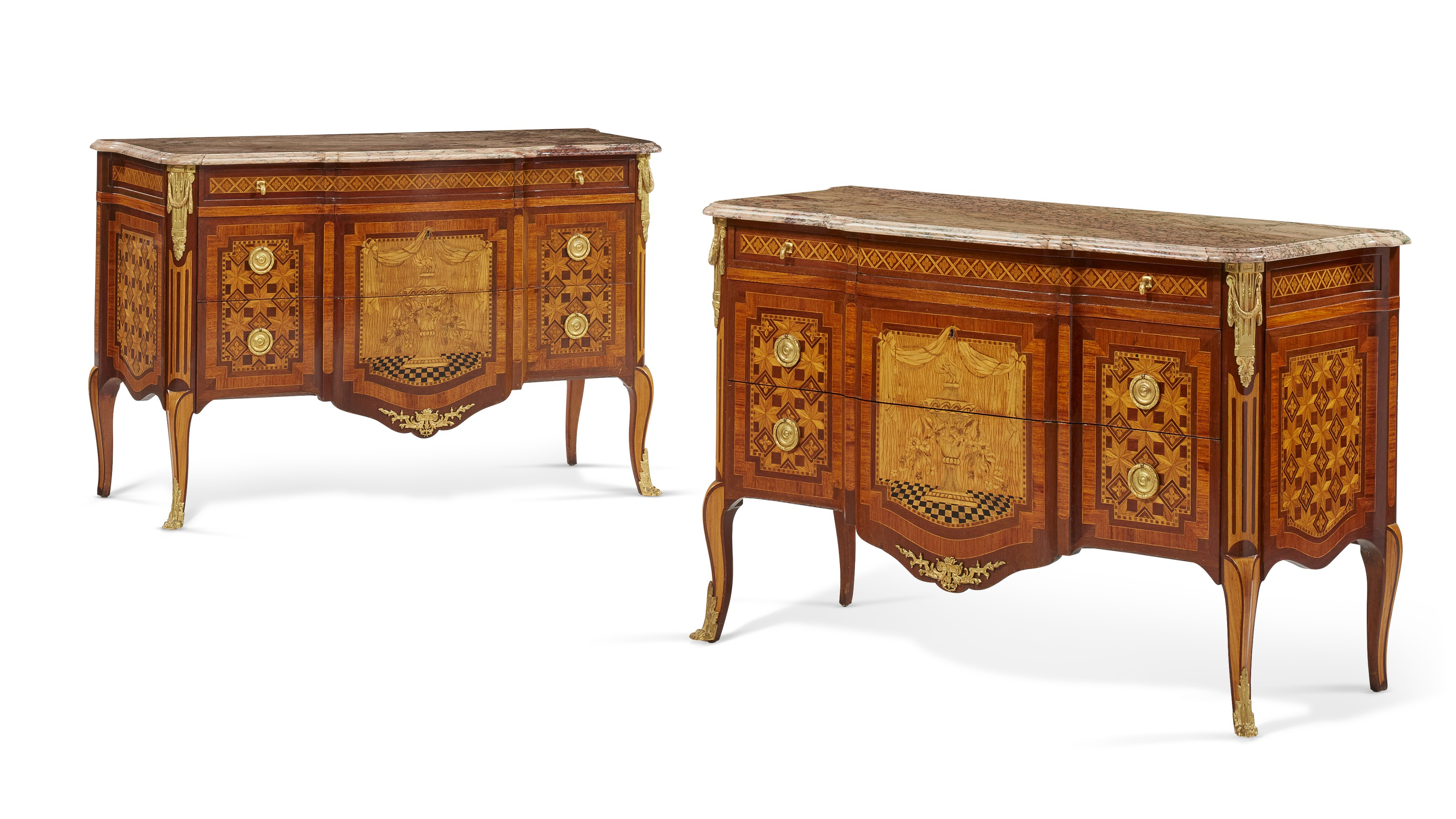 A pair of French ormolu-mounted mahogany, amaranth, fruitwood, marquetry and parquetry commodes, early 20th century. 34  in (86.5  cm) high, 52½  in (133.5  cm) wide, 23¼  in (59  cm) deep. Estimate $8,000-12,000. Offered in The Collector English & European Furniture, Ceramics, Silver & Works of Art on 5-19 October 2021 at Christie's Online