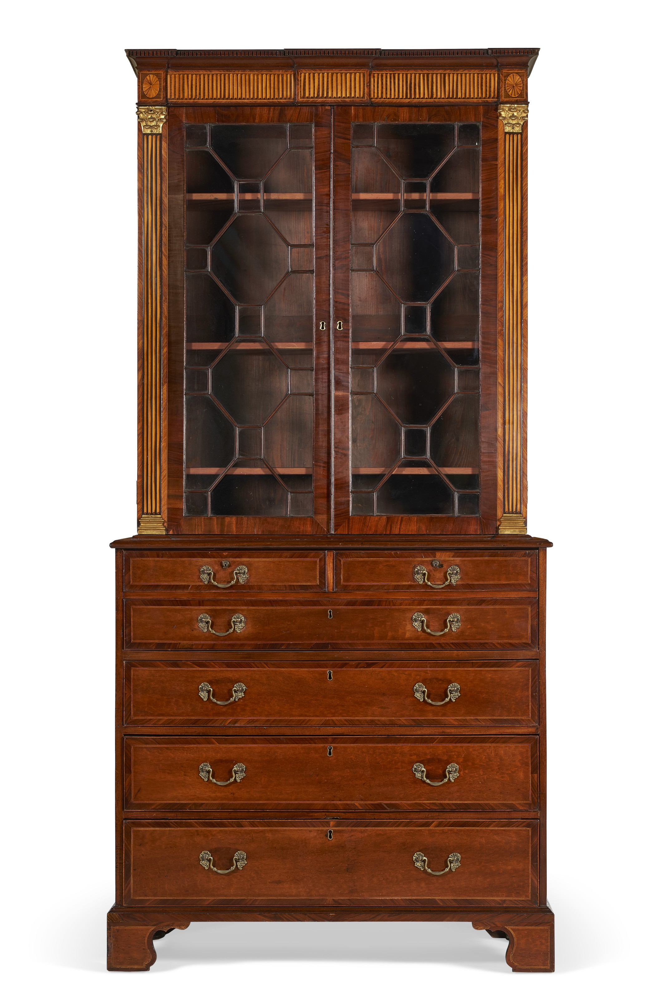 A George III ormolu-mounted and inlaid mahogany and tulipwood banded secretaire bookcase, in the manner of Ince & Mayhew, c. 1780. 89¾  in (228  cm) high, 43  in (109  cm) wide, 21½  in (54.5  cm) deep. Estimate $6,000-10,000. Offered in The Collector English & European Furniture, Ceramics, Silver & Works of Art on 5-19 October 2021 at Christie's Online
