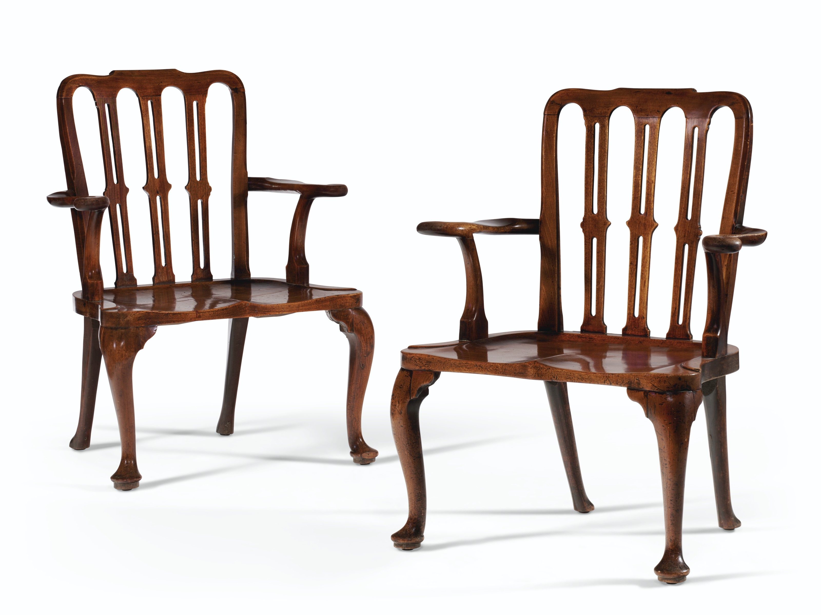 A pair of George II solid mahogany hall armchairs, mid-18th century. Estimate $10,000-15,000. Offered in The Collector English & European Furniture, Ceramics, Silver & Works of Art on 5-19 October 2021 at Christie's Online