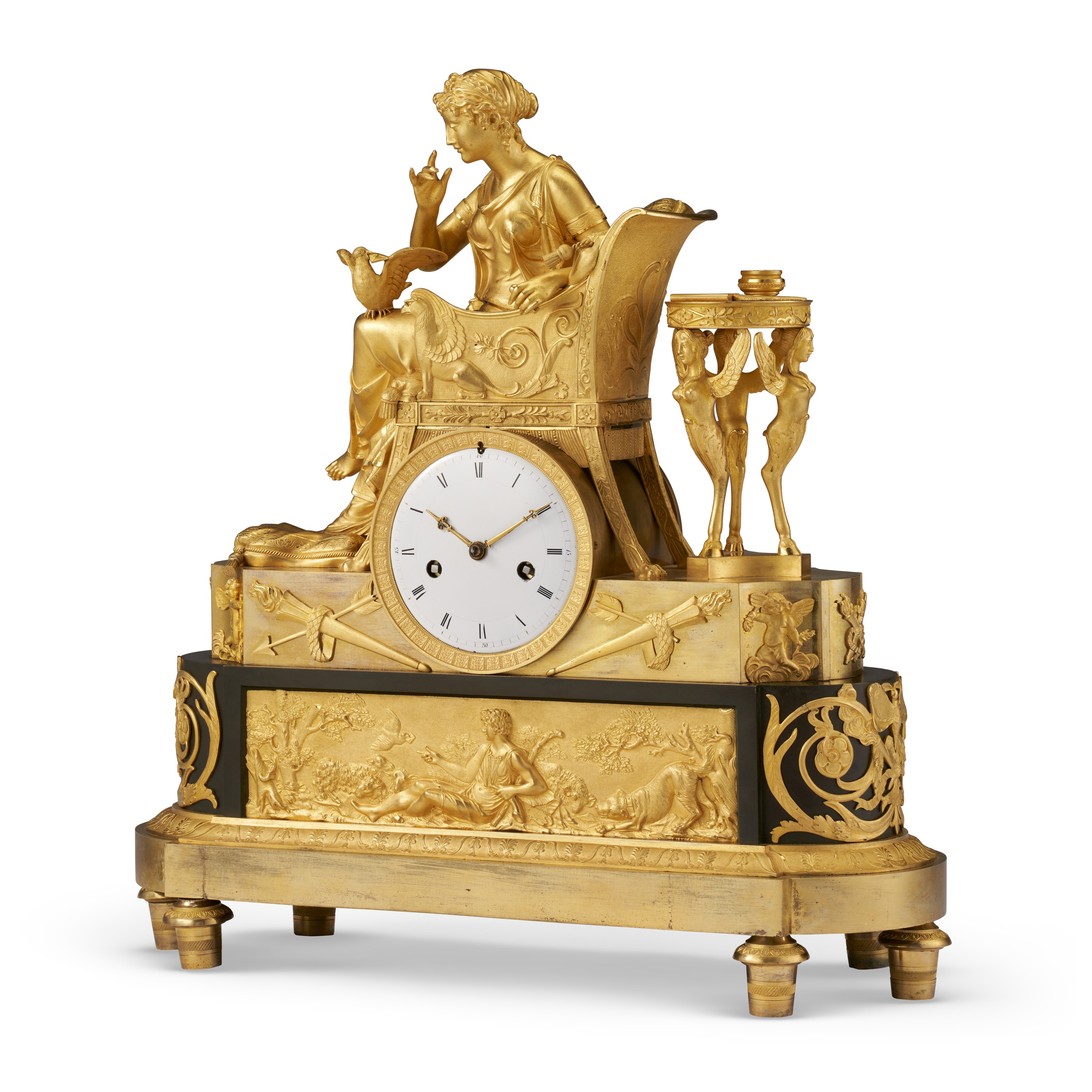 An Empire ormolu and patinated bronze clock, c. 1810. 19  in (48.3 cm) high, 17¾  in (45.1 cm) wide. Estimate $6,000-8,000. Offered in The Collector English & European Furniture, Ceramics, Silver & Works of Art on 5-19 October 2021 at Christie's Online