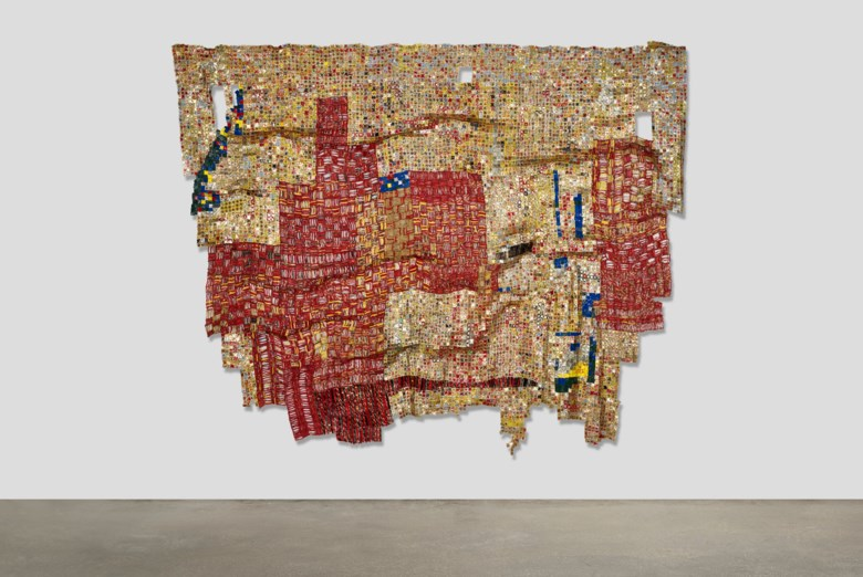 El Anatsui (b. 1944), New Layout, 2009.Found aluminum bottlecaps and copper wire. 88⅝ x 119⅜ x 5⅞ in (225 x 303 x 15 cm). Sold for $1,950,000 on 11 May 2021 at Christie's in New York