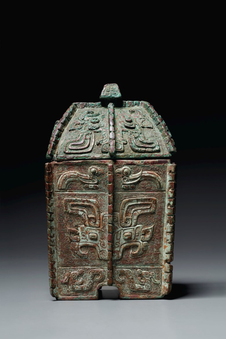 A very rare bronze ritual wine vessel and cover, fangyi. Late Shang dynasty, 12th century B.C. 8 34 in. (22 cm.) high. Estimate $600,000-800,000. Offered in Shang Early Chinese Ritual Bronzes from the Daniel Shapiro Collection on 18 March 2021 at Christies New York