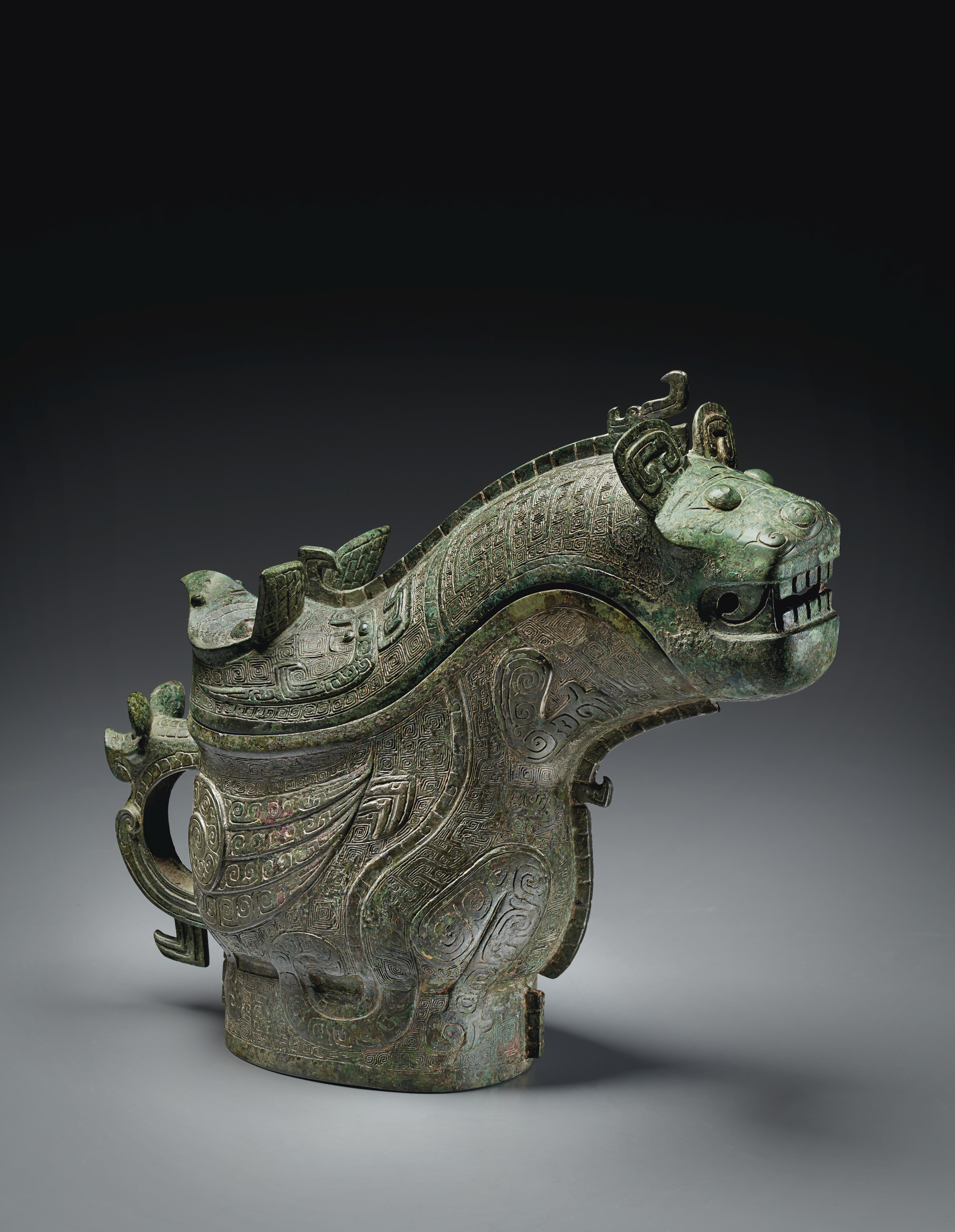 AN EXCEPTIONAL AND HIGHLY IMPORTANT BRONZE RITUAL WINE VESSEL AND COVER, GONG