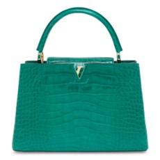 A shiny emerald green alligato