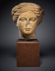 A GREEK MARBLE HEAD OF APOLLO