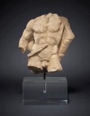 A GREEK LIMESTONE RELIEF FRAGM