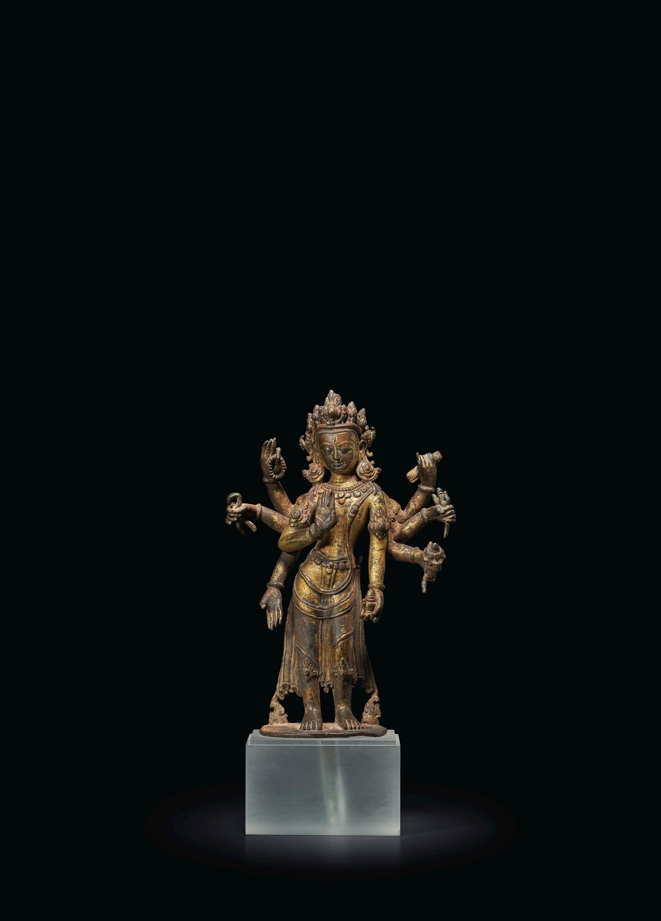 A GILT-BRONZE FIGURE OF AMOGHA