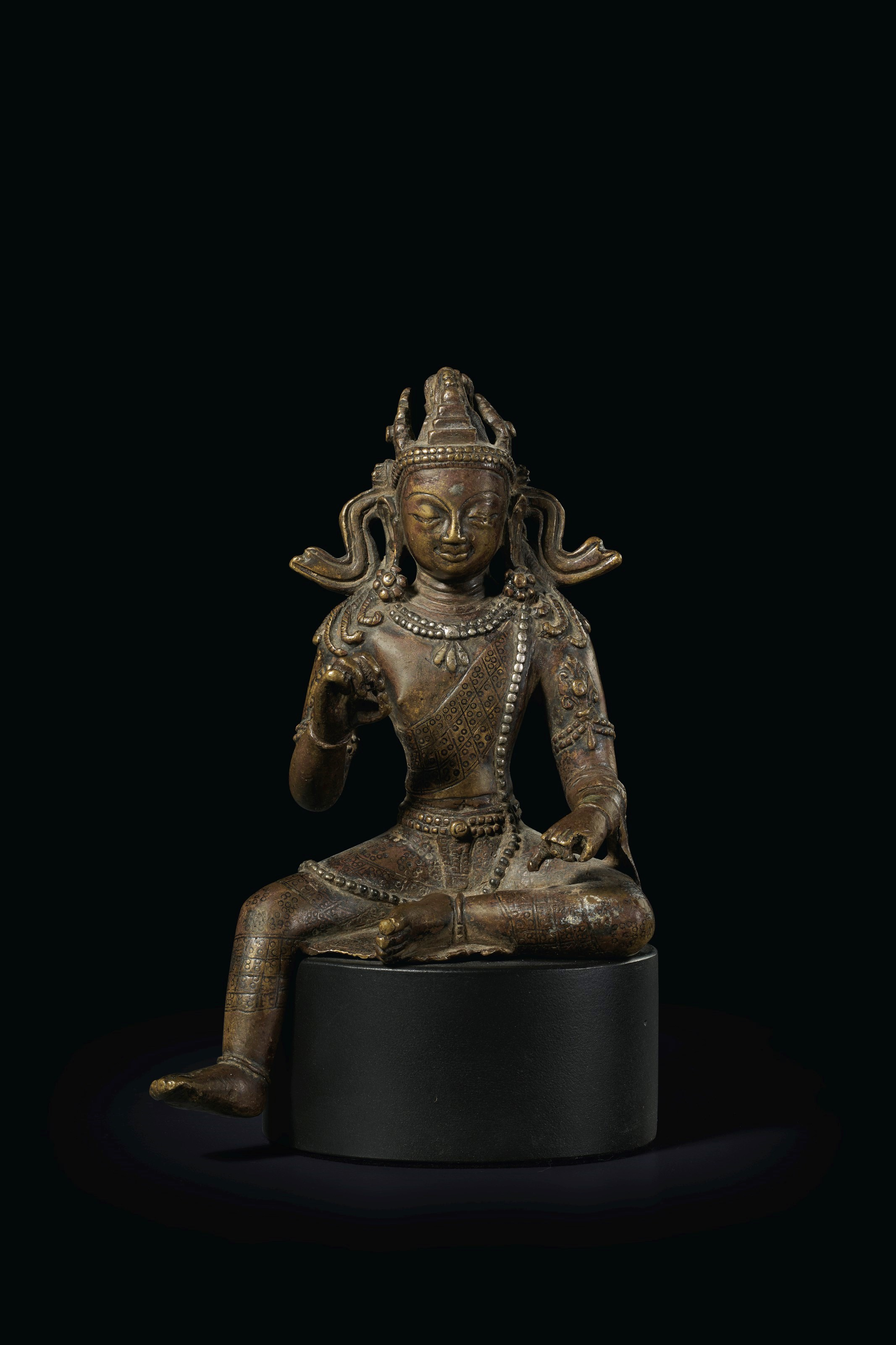 A SILVER-INLAID BRONZE FIGURE