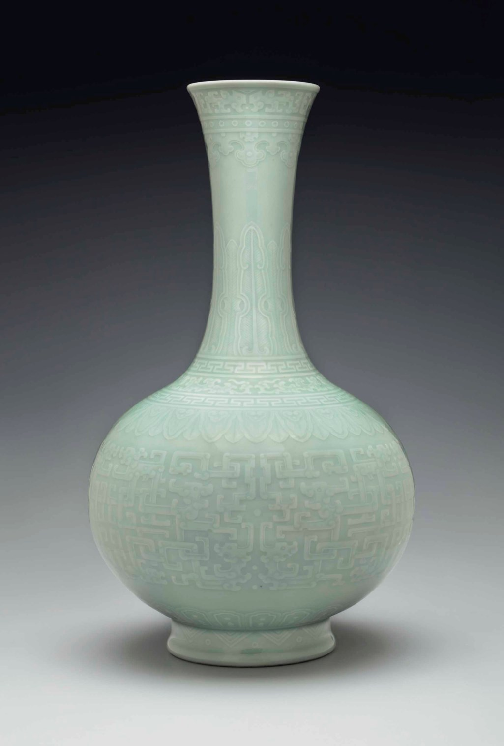 A RARE AND EXCEPTIONAL CELADON-GLAZED RELIEF-DECORATED BOTTLE VASE