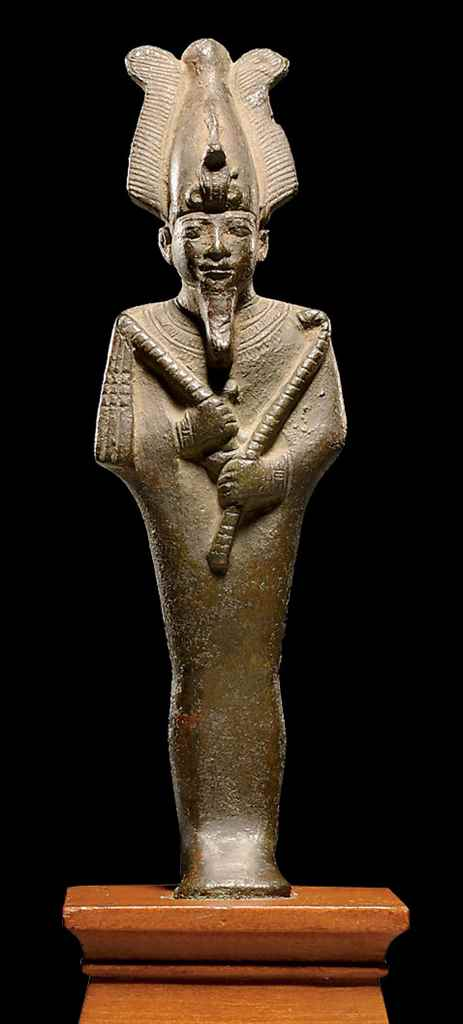 AN EGYPTIAN BRONZE FIGURE OF O