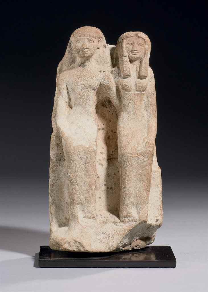 AN EGYPTIAN LIMESTONE PAIR STA