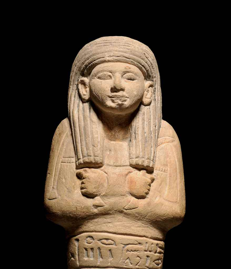 AN EGYPTIAN PAINTED LIMESTONE