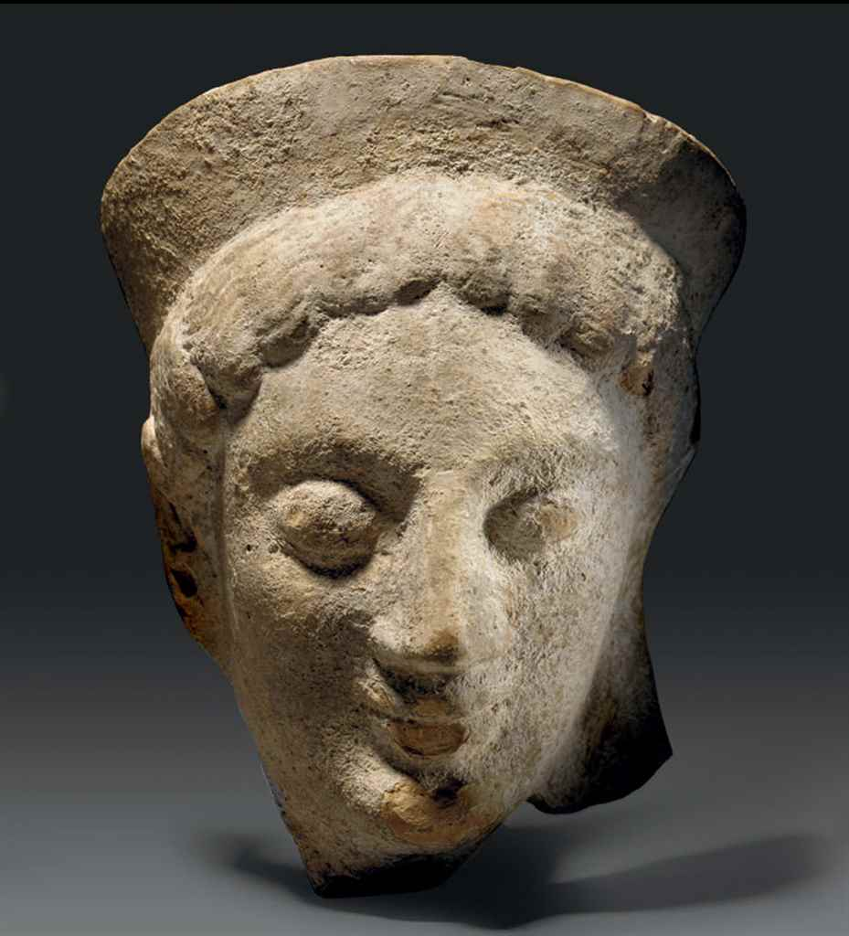 A GREEK TERRACOTTA FEMALE HEAD