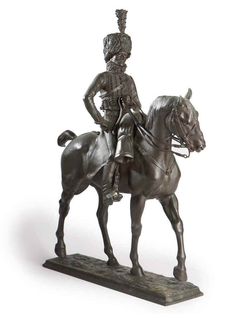 A Bronze Group Of A Hussar