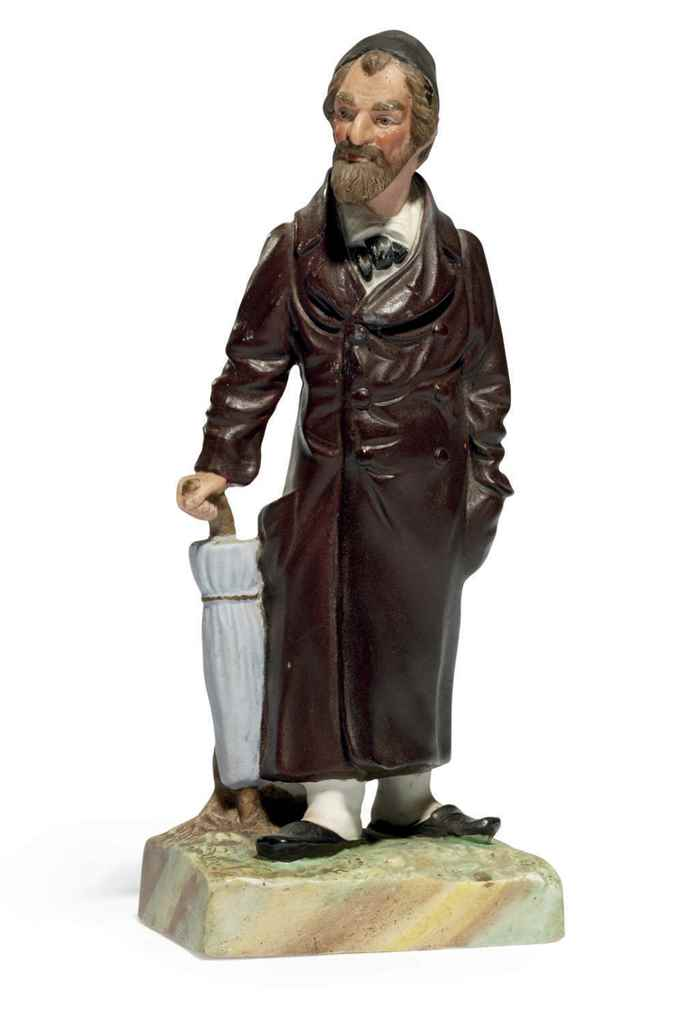 A Porcelain Figurine Of A Jew