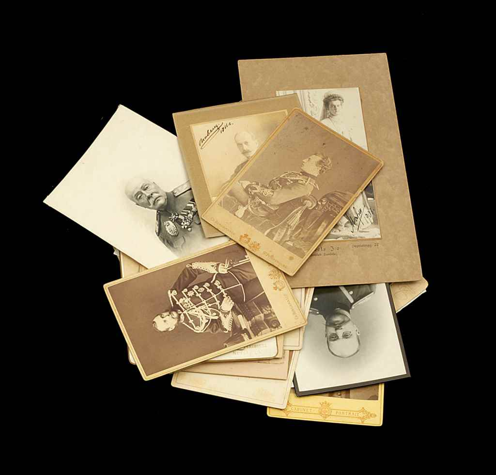A Group of Photographs Depicti