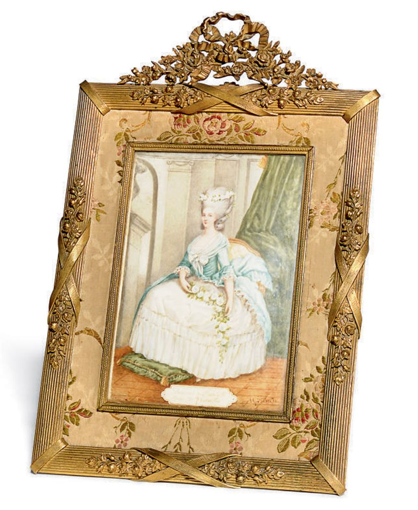 A FRENCH GILT-BRASS FRAME INSE