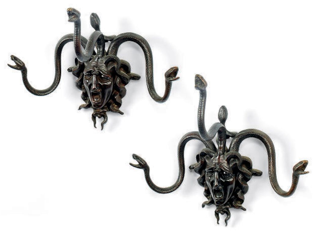 A PAIR OF BRONZE WALL MOUNTS C