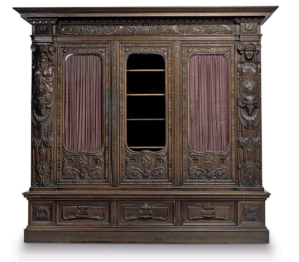 A GERMAN CARVED OAK LIBRARY BO