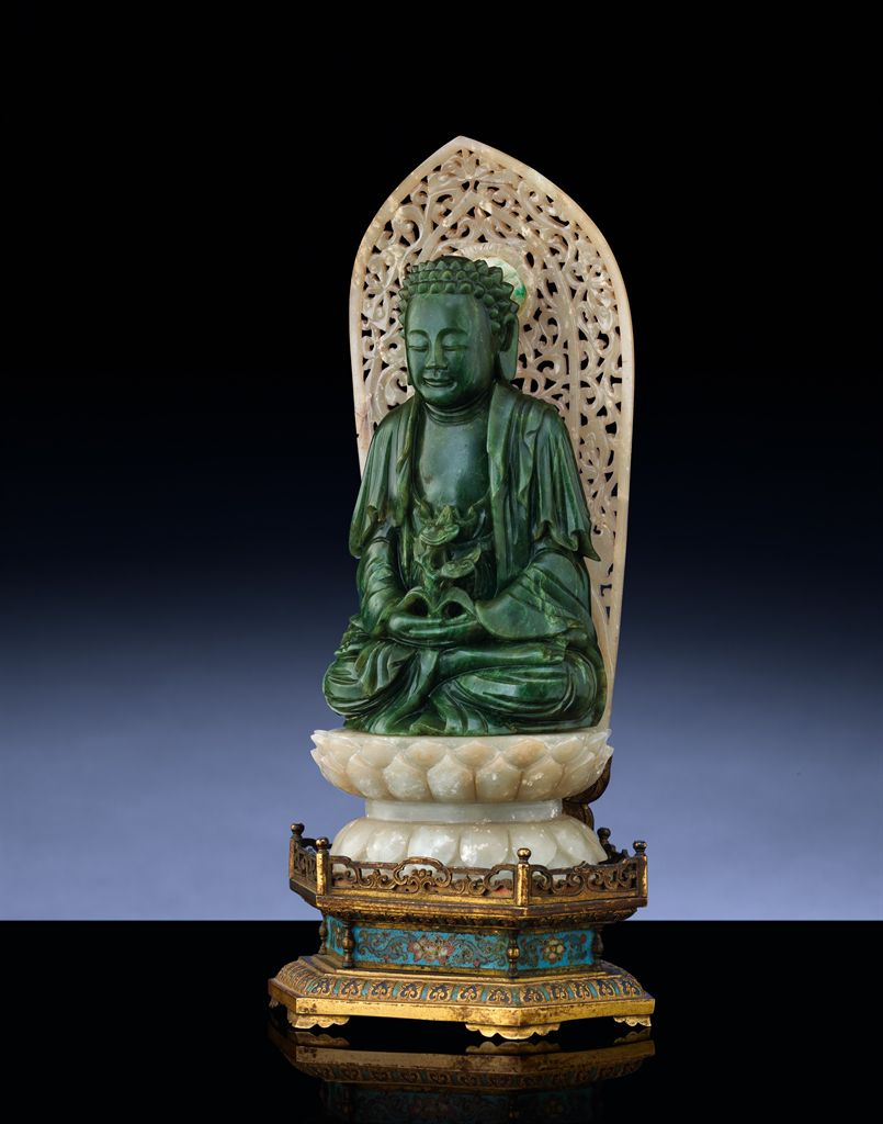A RARE IMPERIAL SPINACH-GREEN JADE FIGURE OF BUDDHA