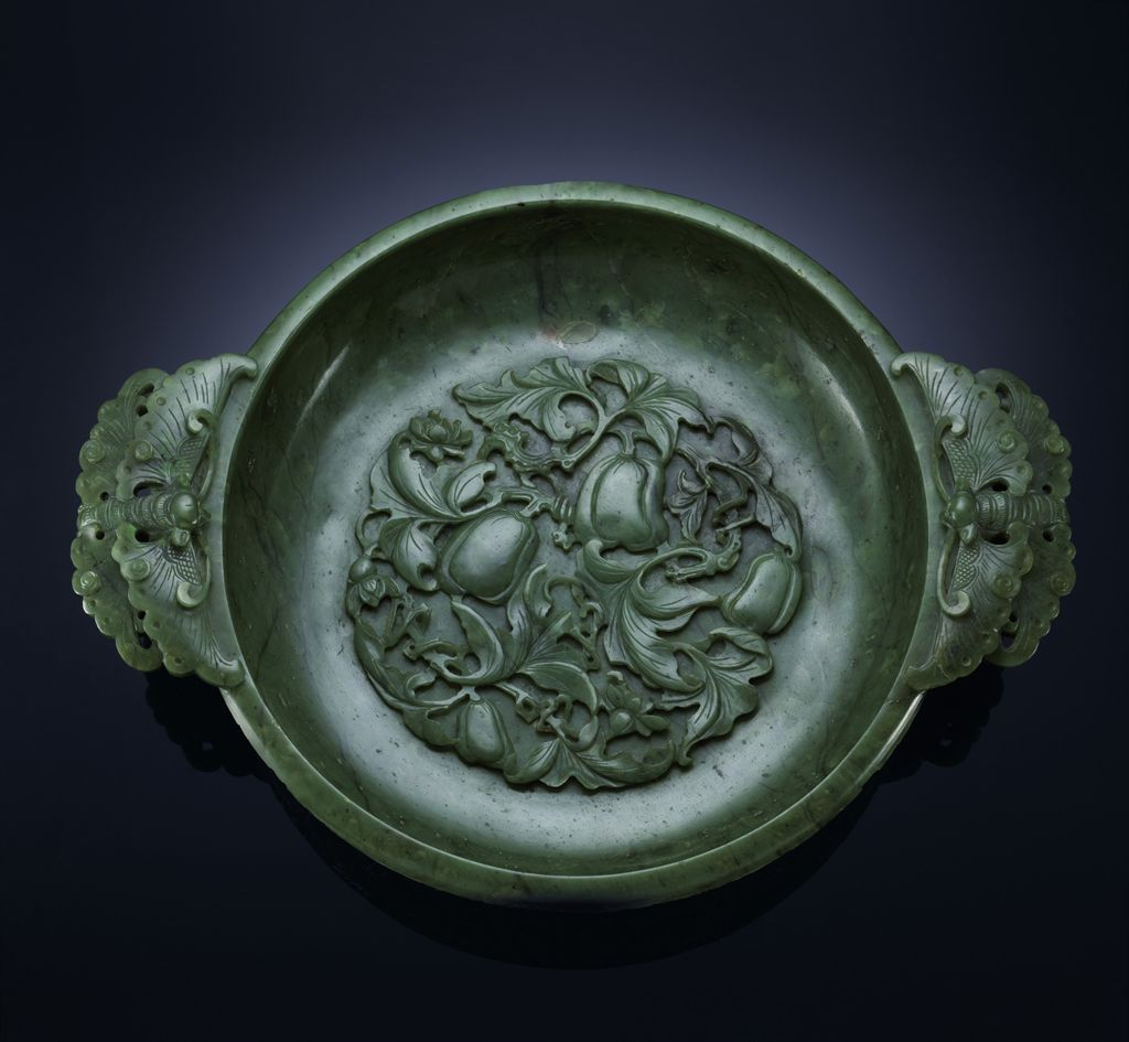 A FINELY CARVED SPINACH-GREEN JADE MARRIAGE BOWL