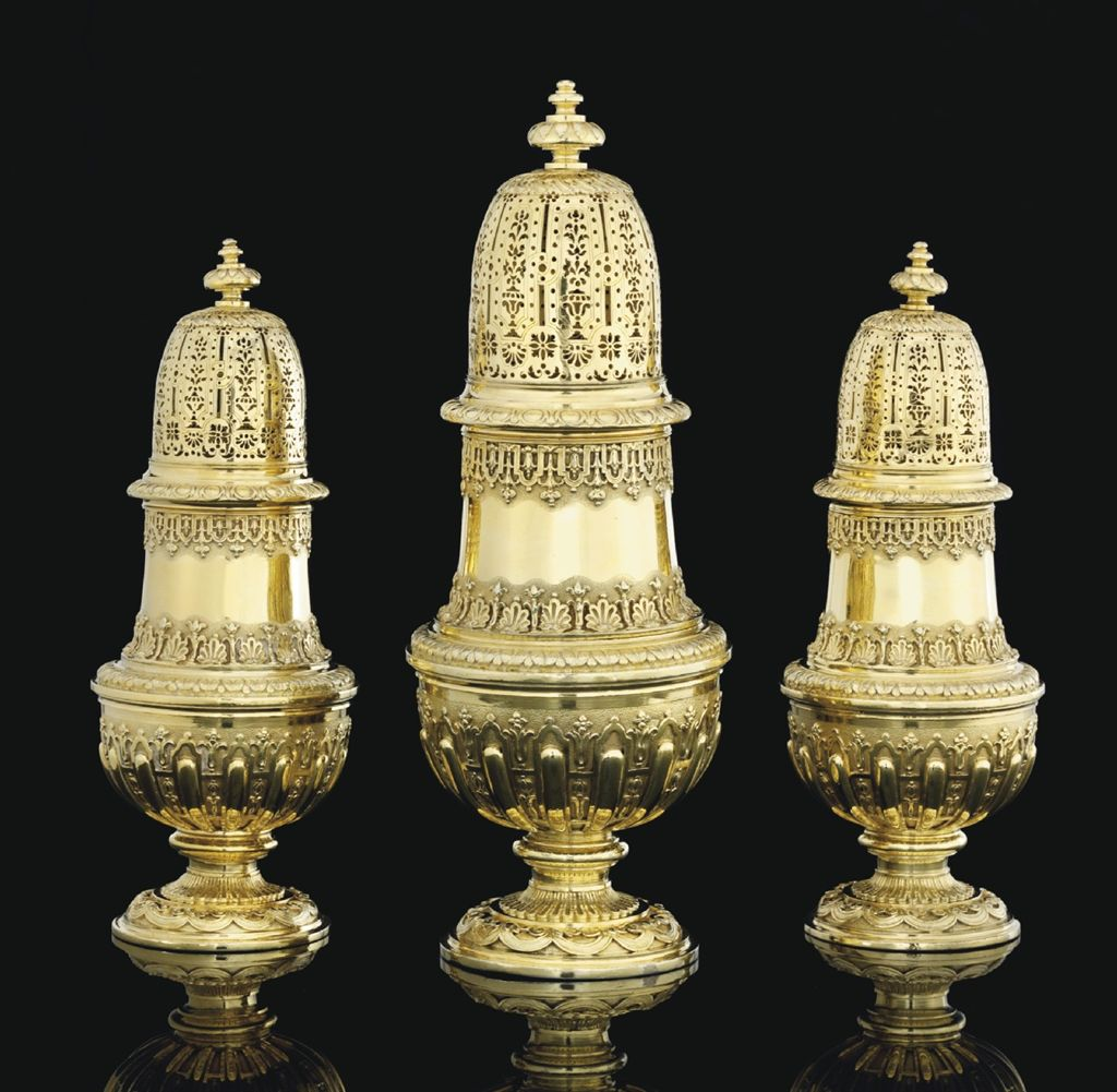 AN IMPORTANT SET OF THREE QUEEN ANNE SILVER-GILT CASTERS