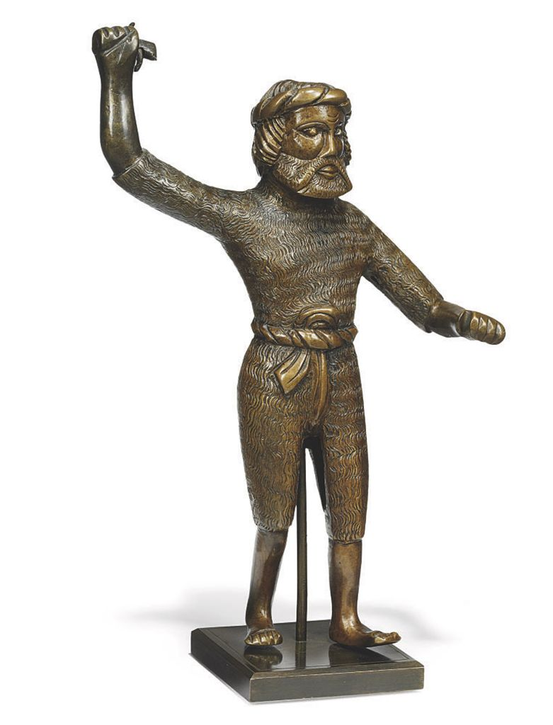 A GERMAN BRONZE FIGURE OF A WI